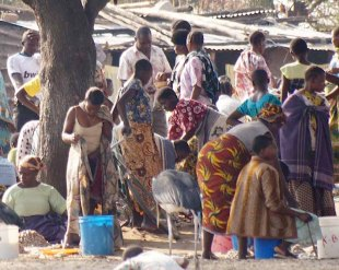 Women doing daily chores of washing clothes, mending fishing nets and much more.