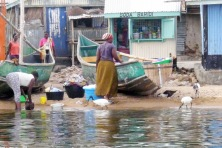 A woman's life on the island--washing clothes and dishes, mending nets and catching fish