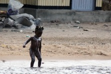 Child bathing in lake victoria