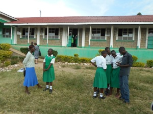 Our helpers Alice and Felix with five of our students at one of our secondary schools.