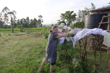 Shiella hanging her laundry