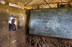We take student girls from this type of mud and dung primary school and put them into secondary school