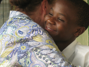 Form 2 student, Elizabeth, basks in a warm hug.